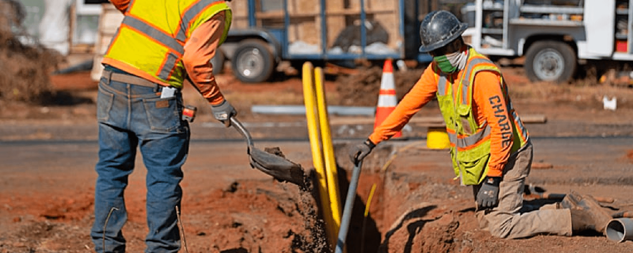 Charge workers in hard hats