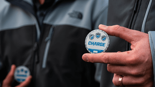 Photo of Charge coin embodying our core values of Safety, Trust, Courage, Collaboration and Compassion